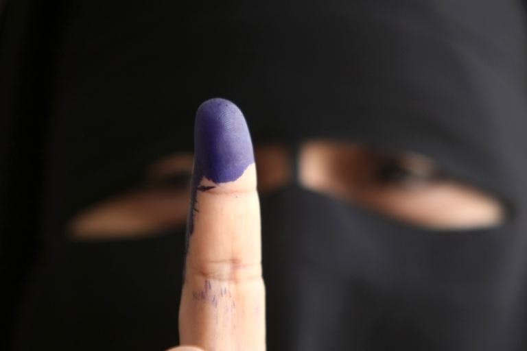 <p>An Egyptian woman shows off her finger stained with indelible ink after voting at a polling station in Cairo on May 23, 2012, in the country's first presidential election since a popular uprising toppled Hosni Mubarak.</p>