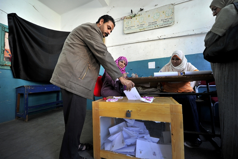<p>An Egyptian man casts his ballot at a polling station in Cairo on March 19, 2011. Egyptians got their first taste of democracy in a referendum to a package of constitutional changes after president Hosni Mubarak was forced to relinquish his 30-year grip on power last month in the face of mass street protests.</p>