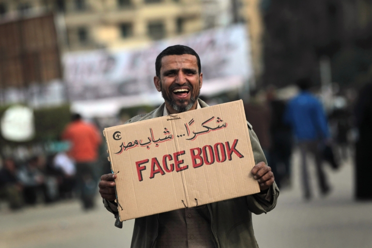 <p>An anti-government demonstrator holds a sign during clashes on Feb. 3, 2011 in Cairo, Egypt.</p>