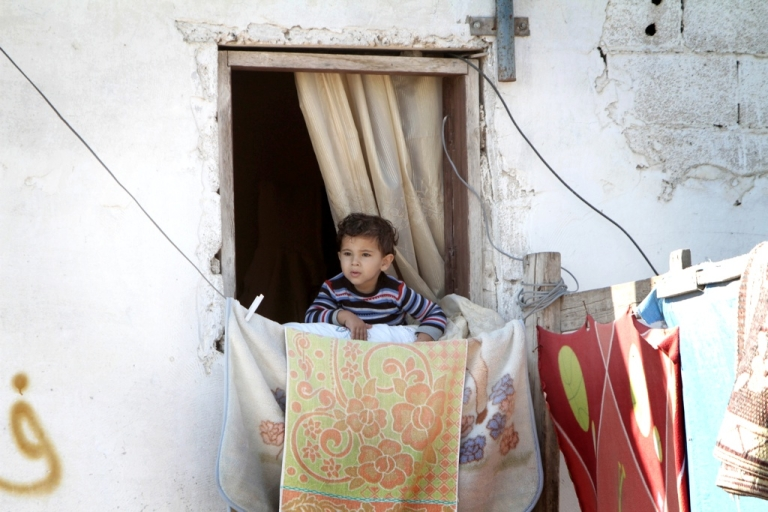 <p>A Palestinian boy watches a funeral in the southern Gaza Strip on Nov. 15, 2012. Tensions between Israel and Gaza have forced Egypt's new government to respond.</p>