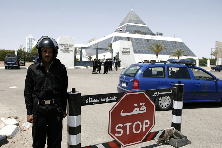 <p>An Egyptian policeman stands guard outside Sharm el-Sheikh hospital where former president Hosni Mubarak was admitted after he reportedly suffered a heart attack yesterday during questioning by prosecutors, in the resort of Sharm el-Sheikh on April 13, 2011.</p>