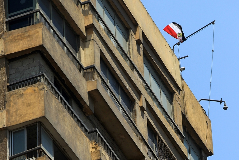 <p>An Egyptian flag flutters over the Israeli embassy in Cairo on August 21, 2011. A lone protester became a hero to an exultant crowd of Egyptians and many more online by hauling down the Star of David flag atop Israel's embassy in Cairo and replacing it with an Egyptian one after the border killing of Egyptian policemen.</p>