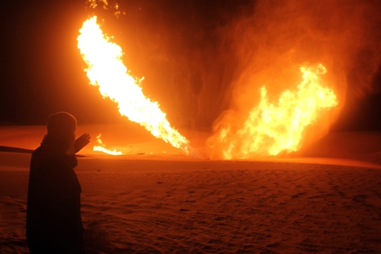 <p>An Egyptian man looks at flames rising from a pipeline that delivered gas to Israel and Jordan after it was hit by an explosion in November 2011.</p>