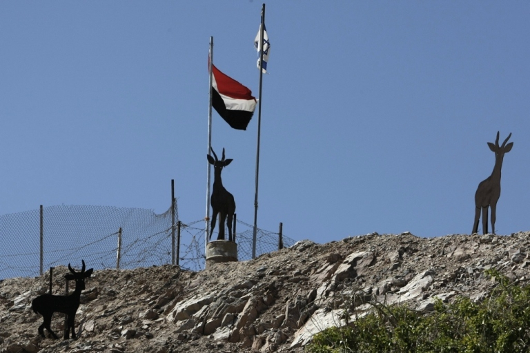 <p>Israeli and Egyptian flags flutter at the Egyptian-Israeli border, along the shore of the Red Sea, near the Taba crossing.</p>