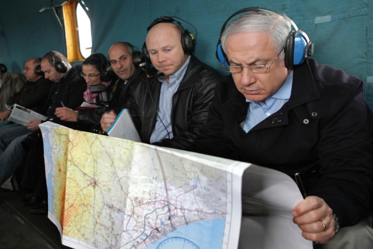 <p>Israeli Prime Minister Benjamin Netanyahu (R) looks at a map of the Israel-Egypt border area during a flight in a military helicopter January 21, 2010 near the Egyptian border, in Israel. Judges investigating non-profits accused of receiving foreign funds in Egypt said one of the key pieces of evidence was the discovery of maps of Egypt inside the NGO offices.</p>