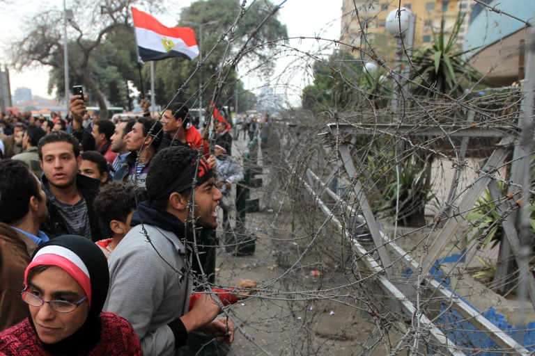 <p>Thousands of Egyptians protest outside the state television headquarters demanding the 'cleansing' of state media, which they accuse of incitement against the protesters in Cairo.</p>
