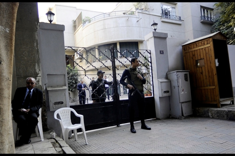 <p>Egyptian soldiers stand guard in front of the US National Democratic Institute, an NGO (non-governmental) rights group in downtown Cairo on December 29, 2011. Egyptian police were searching the Cairo offices of American and Egyptian rights group following orders by the prosecution service which is investigating how the rights groups are financed.</p>