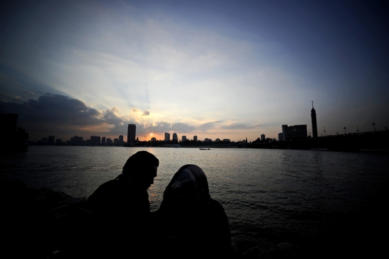 <p>An Egyptian couple enjoys sunset on a bridge overlooking the Nile in Cairo on Dec. 28, 2011.</p>