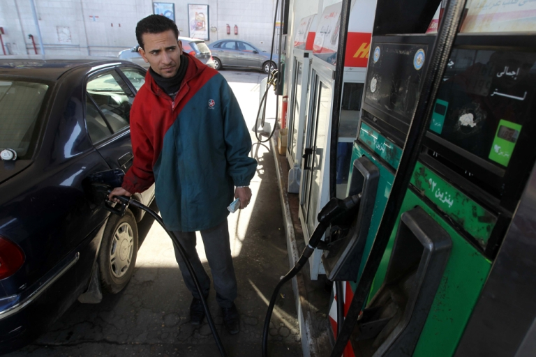 <p>An Egyptian worker fills a customer's car tank at a petrol station in Cairo amid fears of an oil shortage.</p>