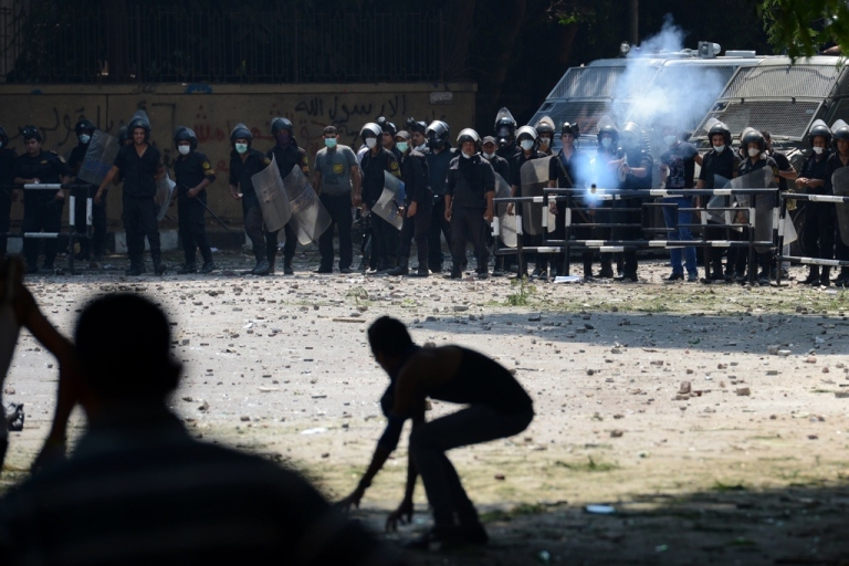 <p>An Egyptian riot police officer fires tear gas towards protesters during clashes with police near the US embassy in Cairo on Sept. 13, 2012.</p>