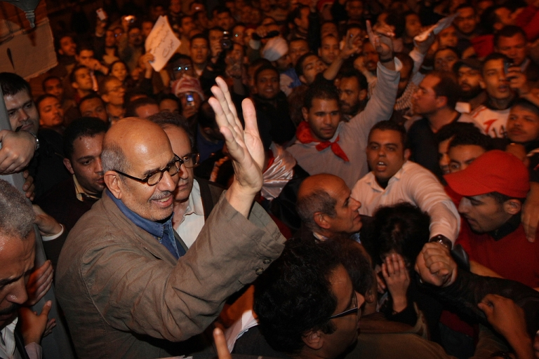 <p>Opposition leader Mohamed ElBaradei waves to supporters in Tahrir Square on January 30, 2011 in Cairo, Egypt.</p>