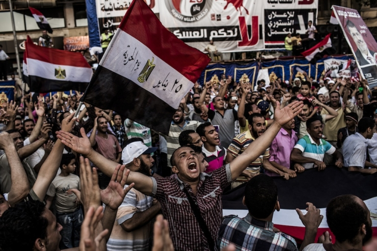 <p>Supporters of Mohamed Morsi, the Muslim Brotherhood's candidate, protest against Egypt's military rulers in Tahrir Square after officials postponed until Sunday the announcement of a winner in last weekend's presidential run-off.</p>