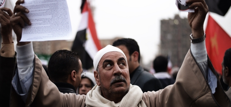 <p>An Egyptian man takes part in a march towards the presidential palace in Cairo on Dec. 4, 2012.</p>