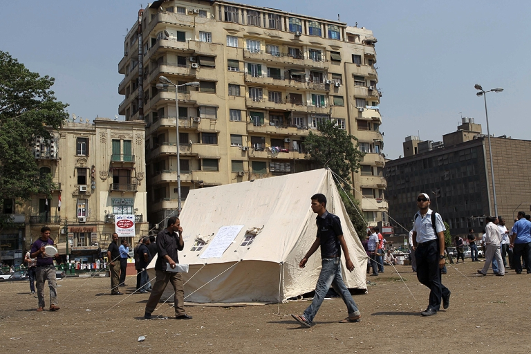 <p>Egyptian pro-democracy activists set-up a tent at Cairo's landmark Tahrir Square on June 30, 2011 as they push for political reforms and to demand that officials found guilty of abuse be brought to justice, a day after violent clashes in the square which was the epicentre of protests that toppled president Hosni Mubarak.</p>