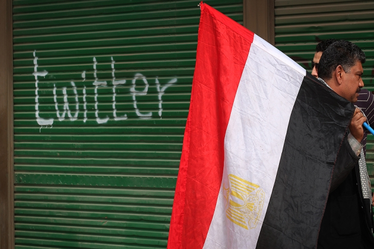 <p>A shop in Tahrir Square is spray painted with the word Twitter after the government shut off internet access on February 4, 2011 in Cairo, Egypt.</p>
