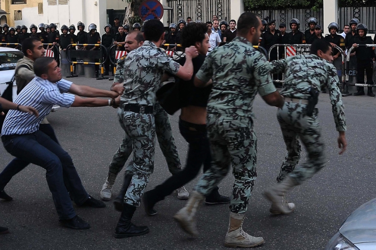 <p>An Egyptian protester scuffles with security forces as they arrest a fellow demonstrator outside the Saudi embassy in Cairo. Egypt's administrative court on June 26, 2012, ruled against a government decree that would have allowed the military to arrest civilians.</p>