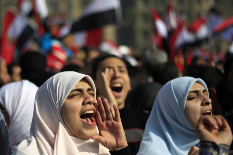 <p>Egyptian Muslim women shout slogans as tens of thousands wave national flags during a rally on January 25, 2012 in Cairo's Tahrir Square to mark the first anniversary of the uprising that toppled Hosni Mubarak, while a debate raged over whether the rally was a celebration or a second push for change.</p>