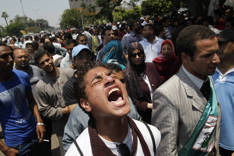 <p>Egyptians protest outside the Supreme Constitutional Court in Cairo on June 14, 2012, as the court examines a law which threatens to bar presidential candidate and former premier Ahmed Shafiq from competing in this weekend's presidential runoff. Egypt's top court ruled unconstitutional a law that would have barred ousted strongman Hosni Mubarak's last premier from standing in a tense presidential poll runoff.</p>
