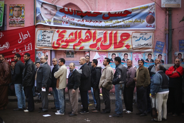 <p>Voters line up outside a polling station on November 28, 2011 in Cairo, Egypt.</p>