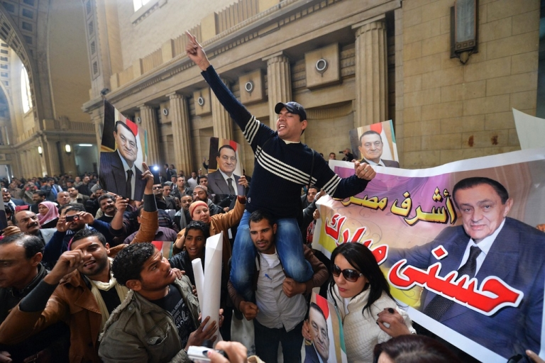 <p>Supporters of ex-president Hosni Mubarak celebrate after the court of Cessation, Egypt's top appeals court, accepted an appeal for a retrial of the ousted president in Cairo on Jan. 13, 2013.</p>
