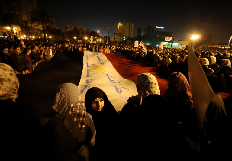 <p>Egyptians gather in Tahir Square to protest their military rulers. Forces raided 17 pro-democracy organizations in Cairo on Thursday.</p>