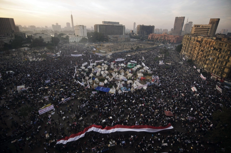 <p>Tens of thousands of protesters gather in Egypt's landmark Tahrir square against a decree by President Mohamed Morsi granting himself broad powers that shield his decisions from judicial review on November 30, 2012 in Cairo.</p>