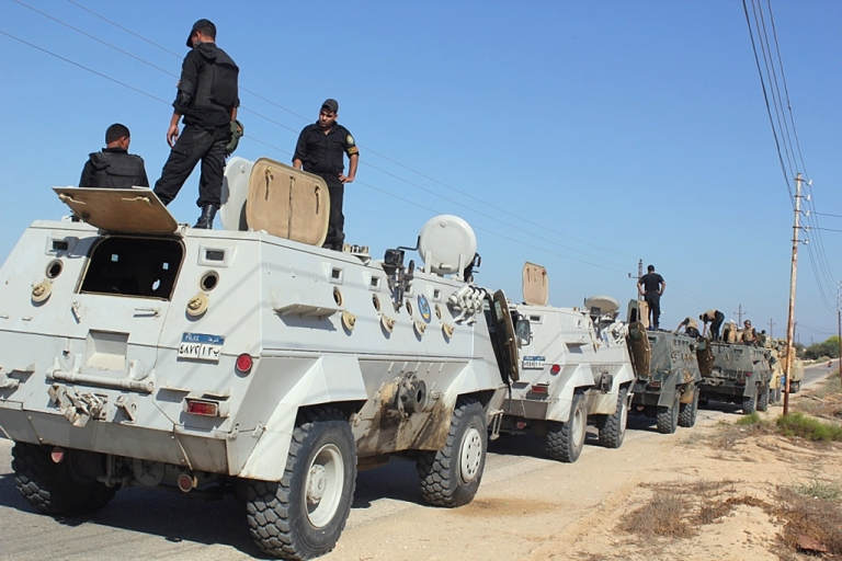 <p>Egyptian security forces stand by their Armoured Personell Carriers ahead of a military operation in the northern Sinai peninsula on August 08, 2012.</p>