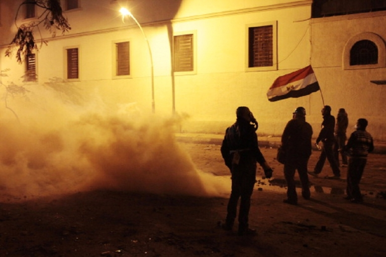 <p>Protesters stand in clouds of tear gas fired by security forces in Cairo, Egypt on Feb. 2.  They were protesting at the handling of a football riot in Port Said that left 74 dead.</p>