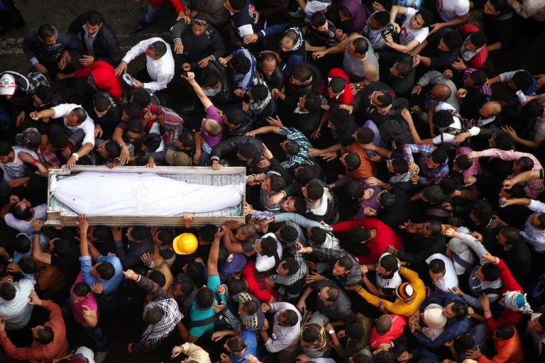 <p>Egyptian Activists and April 6 movement members carry the coffin of Gaber Salah, an activist who died overnight after he was critically injured in clashes near Cairo's Tahrir Square last week, during his funeral at Tahrir square on November 26, 2012 in Cairo. Salah, a member of the April 6 movement known by his nickname