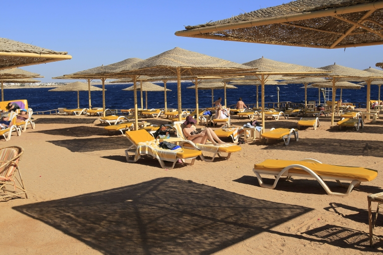 <p>Foreign tourists enjoy the sunny weather at the beach of the Red Sea resort town of Sharm el-Sheikh, some 300 miles east of Cairo, on Jan 3.</p>