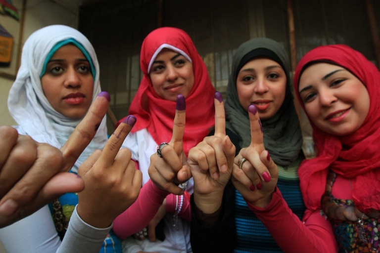 <p>Egyptian women show their ink-stained fingers after voting at a polling station in Cairo on May 24, 2012, in the first round of voting in the country's landmark presidential election.</p>