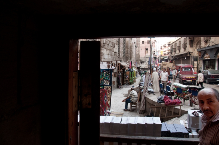 <p>Lightly trafficked stands line the narrow streets of Islamic Cairo in October 2011. Tourism is down 25 percent this year and some vendors are losing hope.</p>