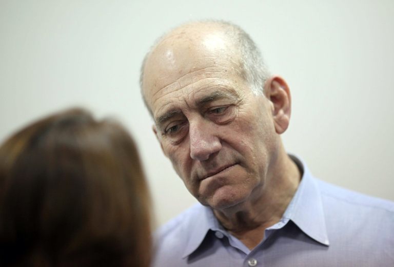 <p>Olmert arrives for the beginning of his corruption trial at the Jerusalem District Court in May.</p>