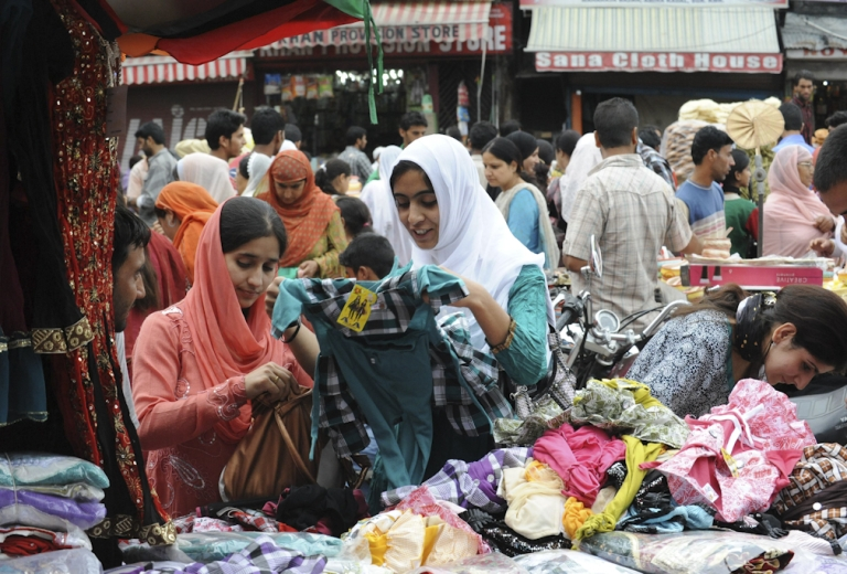 <p>Kashmiri Muslims shop at the central market ahead of Eid-ul-Fitr in Srinagar on August 28, 2011. Markets across the Muslim world witnessed a huge shopping rush during Eid-ul-Fitr which marks the end of Ramadan.The celebrations depend on the appearance of the crescent moon as the Muslim calender is lunar.</p>