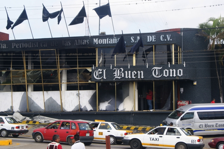<p>Gangsters burn out a Mexican newspaper</p>