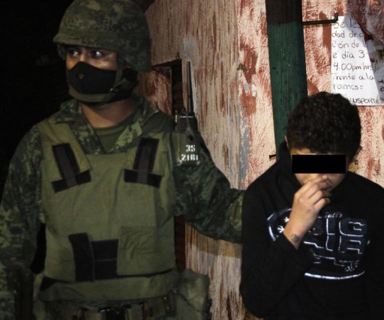 <p>A Mexican soldier escorts Edgar Jimenez Lugo, known as