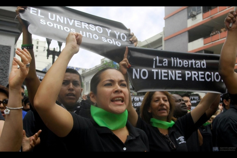 <p>Workers of Ecuador's El Universo newspaper march in protest toward the government palace in Quito on Feb. 17. The National Court of Justice upheld a lower court ruling that sentenced the three top El Universo executives and former opinion page editor Emilio Palacio to three years in prison, and awarded Correa $40 million in damages.</p>