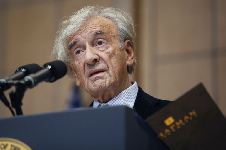 <p>Elie Wiesel introduces US President Barack Obama at the Holocaust Museum April 23, 2012 in Washington, DC. Obama reportedly announced a new sanctions March 23, on Iran and Syria for entities and people using technology to target citizens.</p>