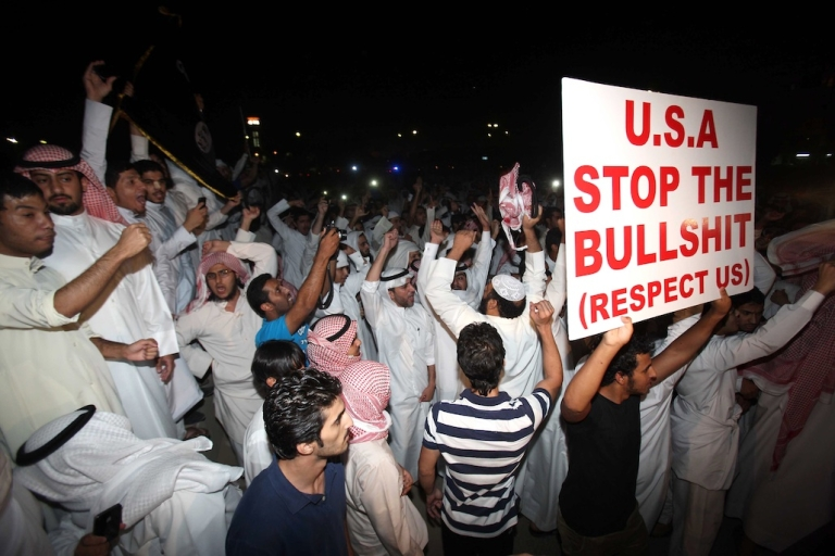 <p>Kuwaitis protest against a film deemed offensive to Islam near the US Embassy in Kuwait City on Sept. 13, 2012. Protests have erupted since Sept. 11 outside US diplomatic missions in several Arab and Muslim states by demonstrators who deem the low-budget movie 'Innocence of Muslims,' made in the United States, offensive to Islam.</p>