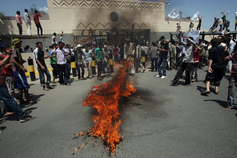 <p>Yemeni protesters gather around fire during a demonstration outside the US Embassy in Sanaa over a film mocking Islam, on Sept. 13, 2012. Yemeni forces managed to drive out angry protesters who stormed the embassy in the capital, with police firing warning shots to disperse thousands of people as they approached the main gate of the mission.</p>
