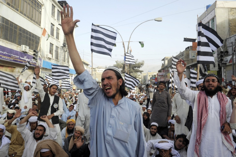 <p>Pakistani Muslims shout anti-US slogans during a rally against an anti-Islam movie in Quetta on September 16, 2012. Pakistan blocked access to the video on the Internet and beefed up security around US diplomatic missions, following attacks on American consulates and embassies in Libya, Egypt and Yemen.</p>