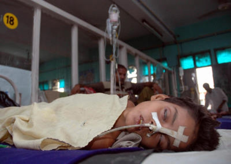 <p>In this picture taken 27 July 2006, An Indian child suffering from Japanese Encephalitis lies on a bed at The Baba Raghav Das Medical College in Gorakhpur,some 250 kilometers (155 miles) southeast of Lucknow.</p>