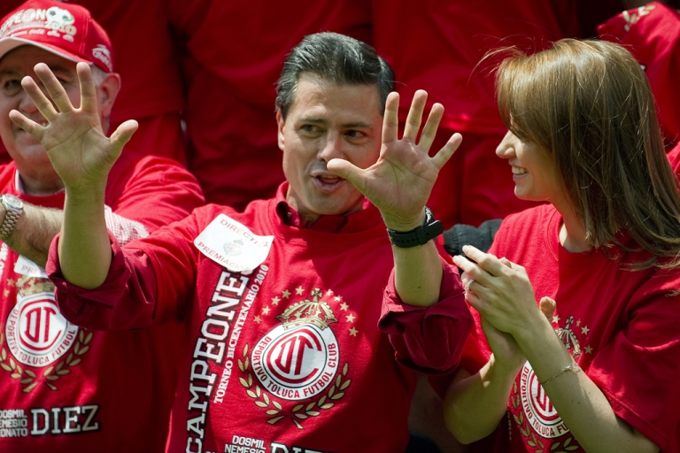 <p>Enrique Pena Nieto and Angelica Rivera celebrate at a soccer match in Toluca, Mexico, on May 23, 2010.</p>