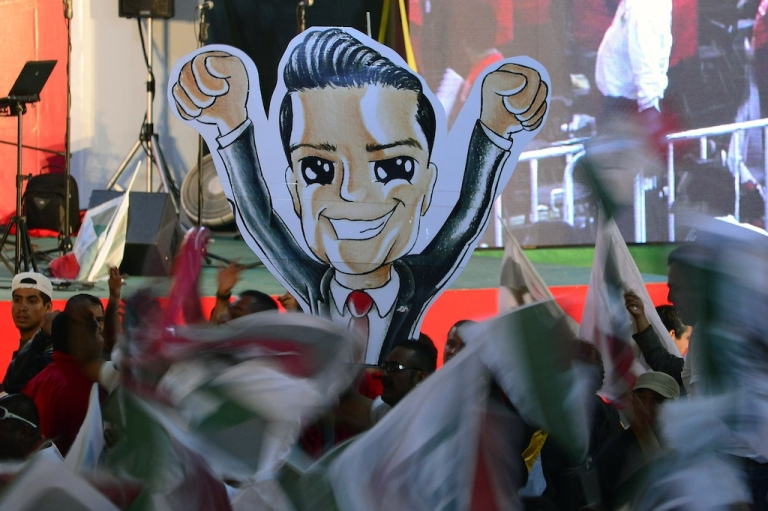 <p>Supporters of Enrique Peña Nieto celebrate at the Institutional Revolutionary Party's headquarters in Mexico City.</p>