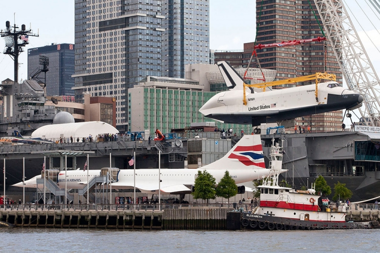 <p>The space shuttle Enterprise is lifted by a crane on to the USS Intrepid on June 6, 2012 in New York City. Upon the Intrepid, the space shuttle will be on display for viewing by the general public. The British Airways Concorde is seen in the foreground.</p>
