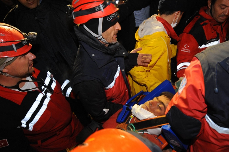 <p>Aydin Palak, 18, is pulled out by Turkish rescuers from the rubble of a collapsed bulding in Ercis on October 27, 2011.</p>