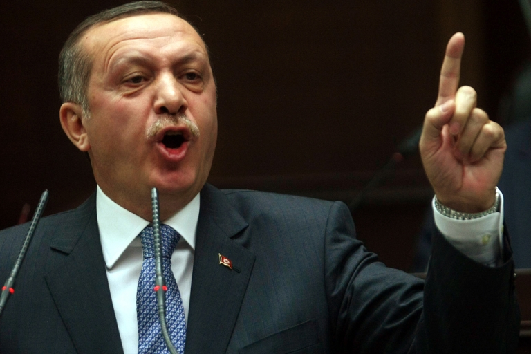 <p>Turkish Prime Minister Recep Tayyip Erdogan addresses lawmakers at the parliament in Ankara on January 24, 2012. Recep Tayyip Erdogan on Tuesday slammed as discriminatory and racist a bill passed by the French Senate making denial of the Armenian genocide a crime.