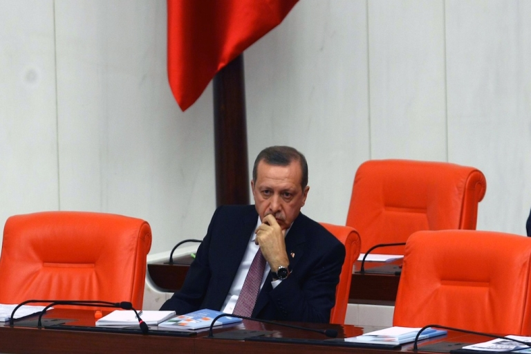 <p>Turkish Prime Minister Recep Tayyip Erdogan sits in Parliament on December 10, 2012. Erdogan has been behind many repressive new laws that human rights groups say violate political freedoms.</p>