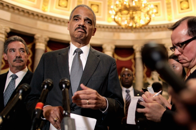 <p>Attorney General Eric Holder (C) talks to reporters with Deputy Attorney General James Cole (L) after meeting with House Oversight and Government Reform Committee Chairman Darrell Issa in the U.S. Capitol June 19, 2012 in Washington, DC. The Obama administration invoked executive privilege on June 20, 2012, to withhold the release of documents related to the Fast and Furious program, while the committee planned to vote to hold Holder in contempt of Congress.</p>