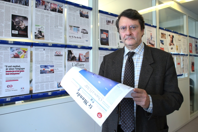 <p>Editorial director of French daily newspaper Le Monde, Erik Izraelewicz, poses in the paper's headquarters on November 19, 2012 in Paris during the close of deadlines for the day's edition.</p>